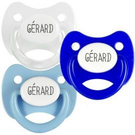 3 Tétines Personnalisées: Blanc anneau transparent, Bleu capuchon blanc y Bleu ciel blanc